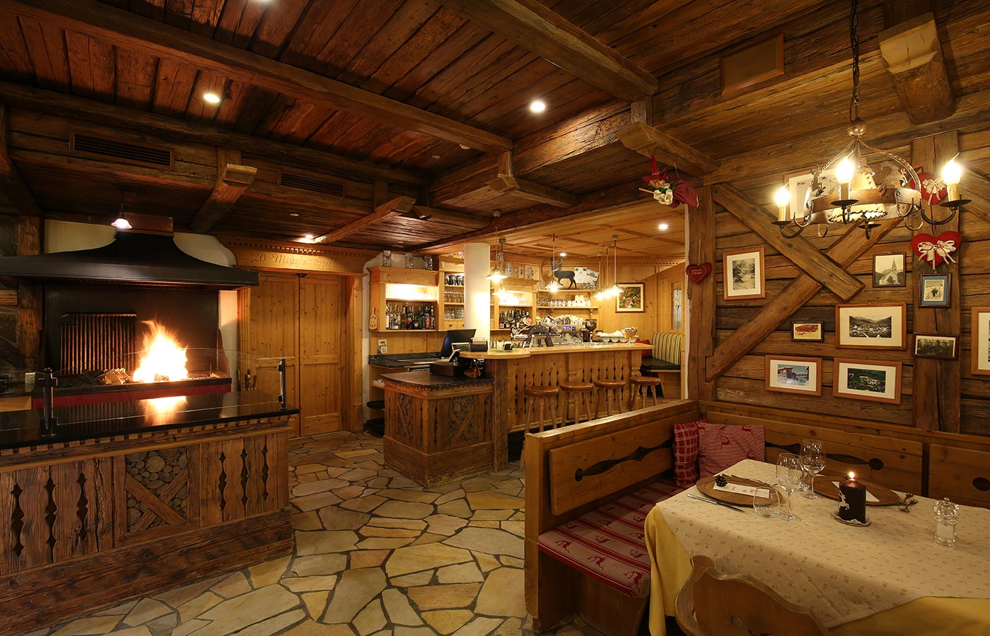 Interior of the restaurant Miky's Grill, entirely decorated in wood with oven on