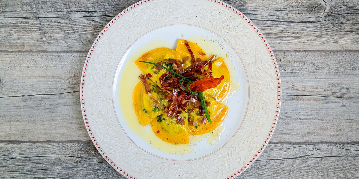 Ravioli dish with butter and speck